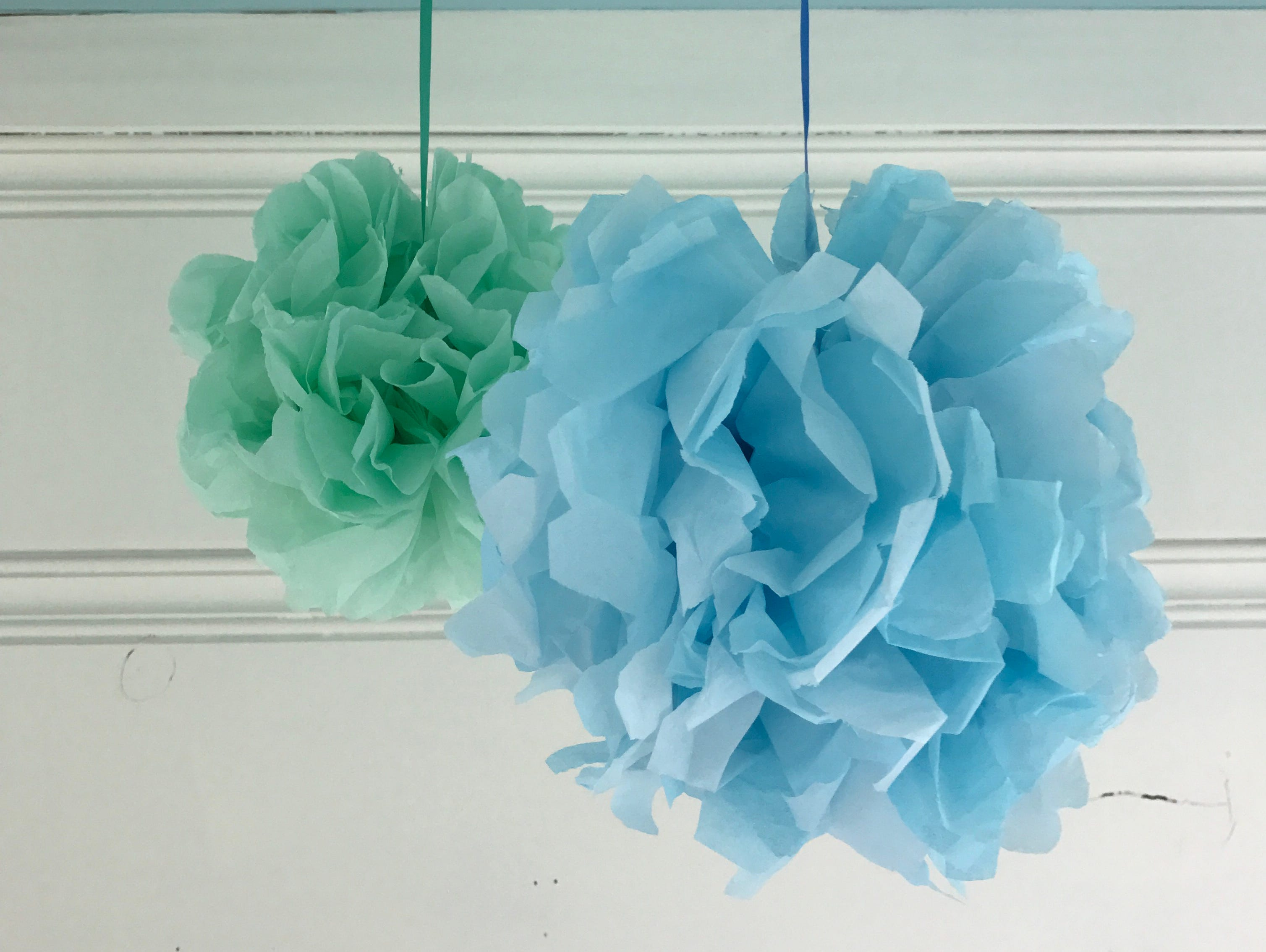 These tissue paper pom-poms are a fun and festive element that you can whip up in minutes.