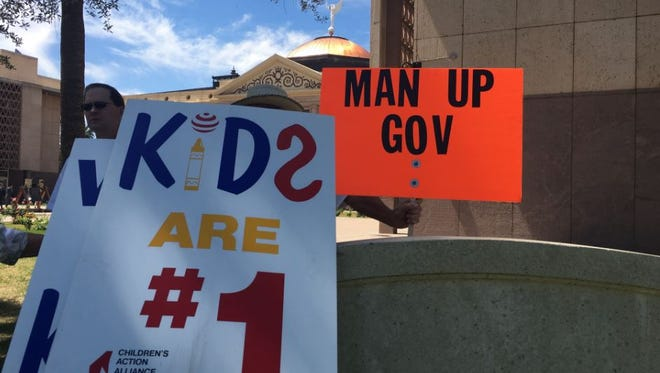 Supporters of KidsCare rallied at the state capitol on Monday morning.