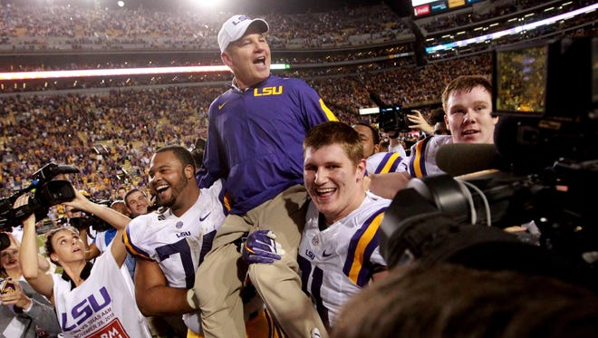 LSU head coach Les Miles is picked up by his players after defeating the Texas A&M Aggies 19-7 at Tiger Stadium in November.