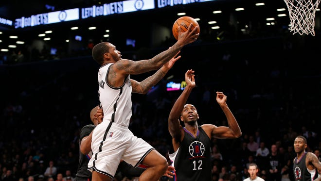 Brooklyn Nets guard Sean Kilpatrick (6) drives to the basket with Los Angeles Clippers forward Luc Richard Mbah a Moute (12) defending during overtime of Tuesday's game.