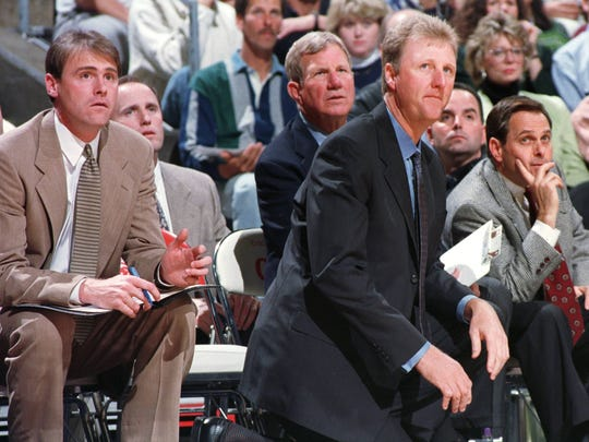 Dan Burke, behind Rick Carlisle on the left in a 1997 game versus Sacramento, has been in the background for the Pacers since Larry Bird's coaching tenure.