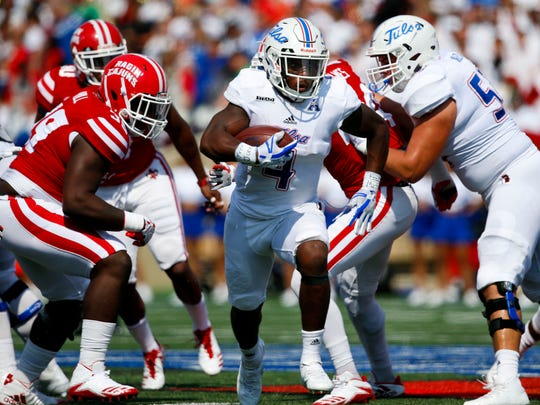 D'Angelo Brewer (4) runs the ball in the first half of the game between the Tulsa Golden Hurricane and Louisiana Ragin' Cajuns at H.A. Chapman Stadium in Tulsa on Saturday Sept. 9, 2017.