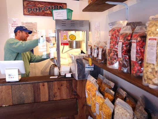 Operations Manager Jeff Anderson bags some fresh-popped popcorn at Greendale's The Popcorn Shoppe at 5632 Parking St.