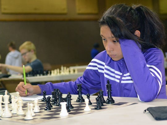 Roma Plansencia, 12, from El Paso writes down her moves