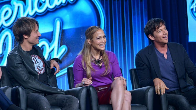 """Judges, from left, Keith Urban, Jennifer Lopez, and Harry Connick Jr. are seen during a panel of """"American Idol."""""""