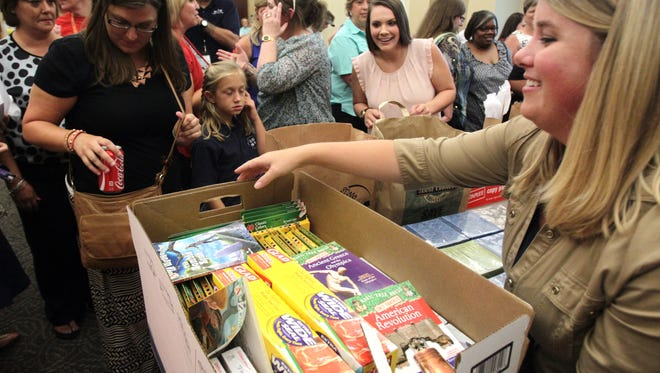 Acadiana teachers collecting Adopt-a-Teacher supplies during the 2014 event.