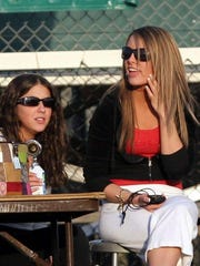 Amanda Saccomanno, right, at a Yorktown boys lacrosse game in high school. She kept the stats, scores and clock.