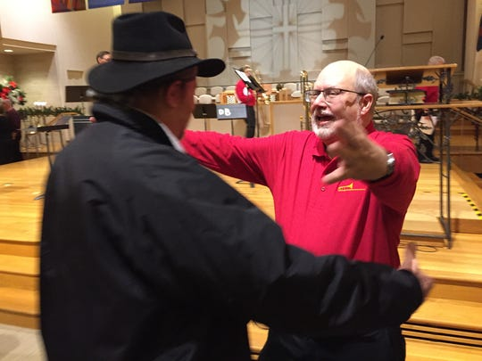 Jerry Heilner, right, reaches out to hug one of the people who showed up to hear a trombone choir concert on Jan. 5 at Derry Presbyterian Church in Hershey.