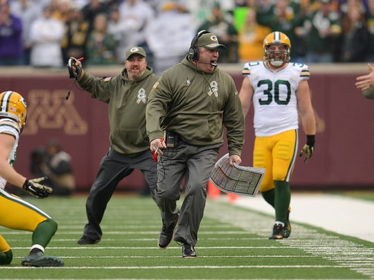 Green Bay Packers head coach Mike McCarthy screams with anger after a play against the Minnesota Vikings during Sunday's game at TCF Bank Stadium on the campus of the University of Minnesota in Minneapolis. McCarthy was upset because a pass interference penalty was not given to the Vikings. Evan Siegle/Press-Gazette Media
