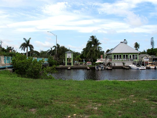 A food park is planned on the vacant lot, foreground, across Haldeman Creek from the Three60 Market, background right, off Bayshore Drive in Naples.