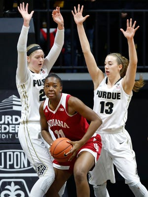 Bree Horrocks and Bridget Perry combine to defend Indiana's Kym Royster Sunday at Mackey Arena. Purdue beat Indiana 63-53.