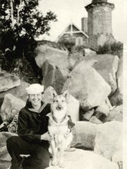 Gert Wellisch poses with her dog, Sandy, in front of