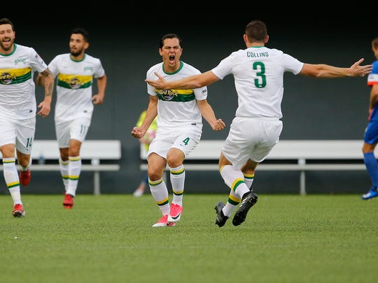 Tampa Bay Rowdies midfielder Marcel Shafer (4), center, celebrates after scoring a goal in the first half.
