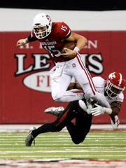 University of South Dakota quarterback Chris Streveler (15) breaks through a tackle during the second half at the DakotaDome on Saturday, Oct. 7, 2017 in Vermillion, S.D.