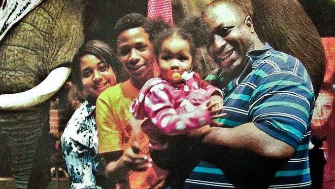 Eric Garner with his family