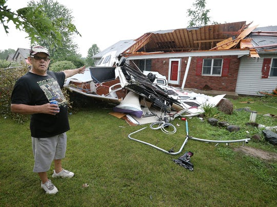 Damage from a possible tornado ripped downed trees and damaged homes just east of Plainfield. Here, Don Rackley talks about his neighbors RV that flew into the roof of his home.