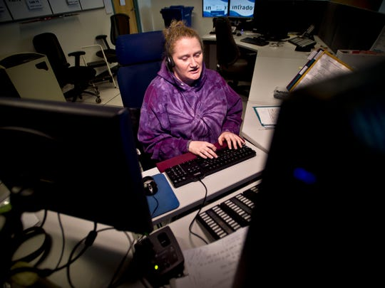 Vermont State Police dispatcher Chrystal Yantz takes a 911 call at the dispatch center at the Williston barracks on Feb. 3.