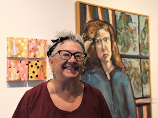 """Mary K. Huff, a member artist at The Center for Contemporary Arts, stands by her two works that are part of the """"Then & Now"""" group show. Her pieces are """"Cute Little Dress 1-4,"""" 2018 mixed media, and """"First,"""" a oil and canvas from 1978."""