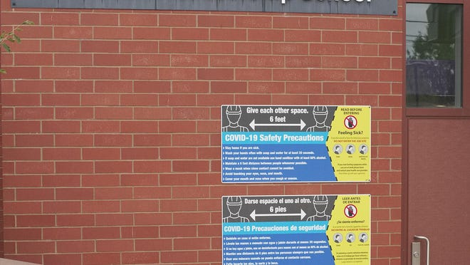 COVID-19 safety precaution signage at Pell Elementary school.