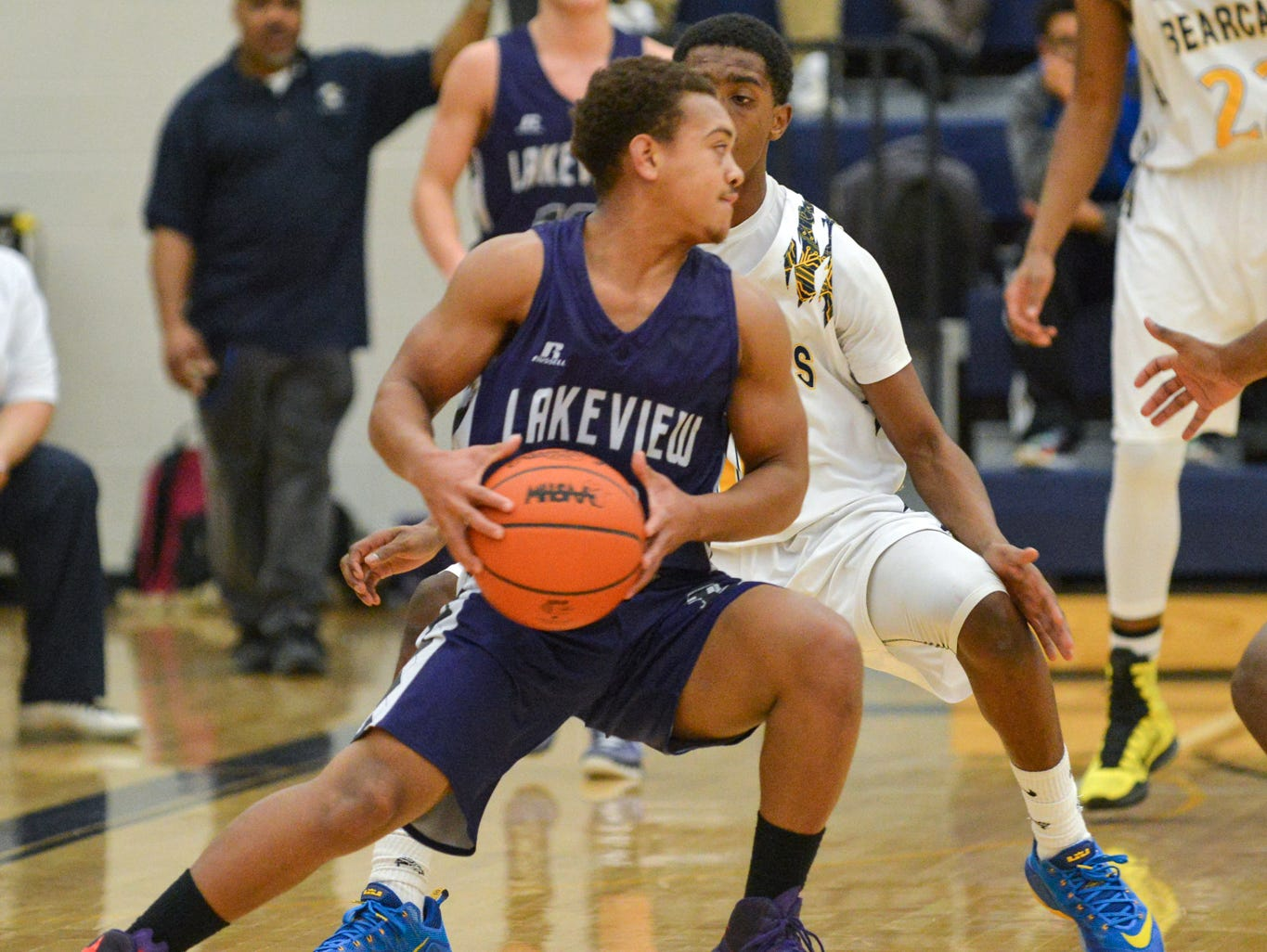 Lakeview's CJ Foster works to drive through Central defenders Thursday night.