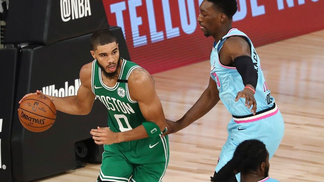 Celtics forward Jayson Tatum (0) is guarded by Heat forward Bam Adebayo during the second half on Tuesday night.