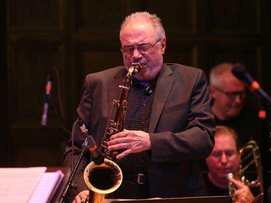 Pat LaBarbera plays the sax with the John LaBarbera