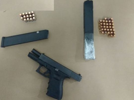 Police found this gun and two extended magazines with ammunition in the vehicle.