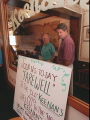 """A sign bade """"farewell"""" and """"hello"""" to customers at Keenan's restaurant on August 2, 1996, its last day of operation on Hudson Avenue."""