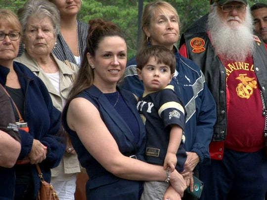 Navy Veteran Mike Dowens' wife Christine and son Greyson,