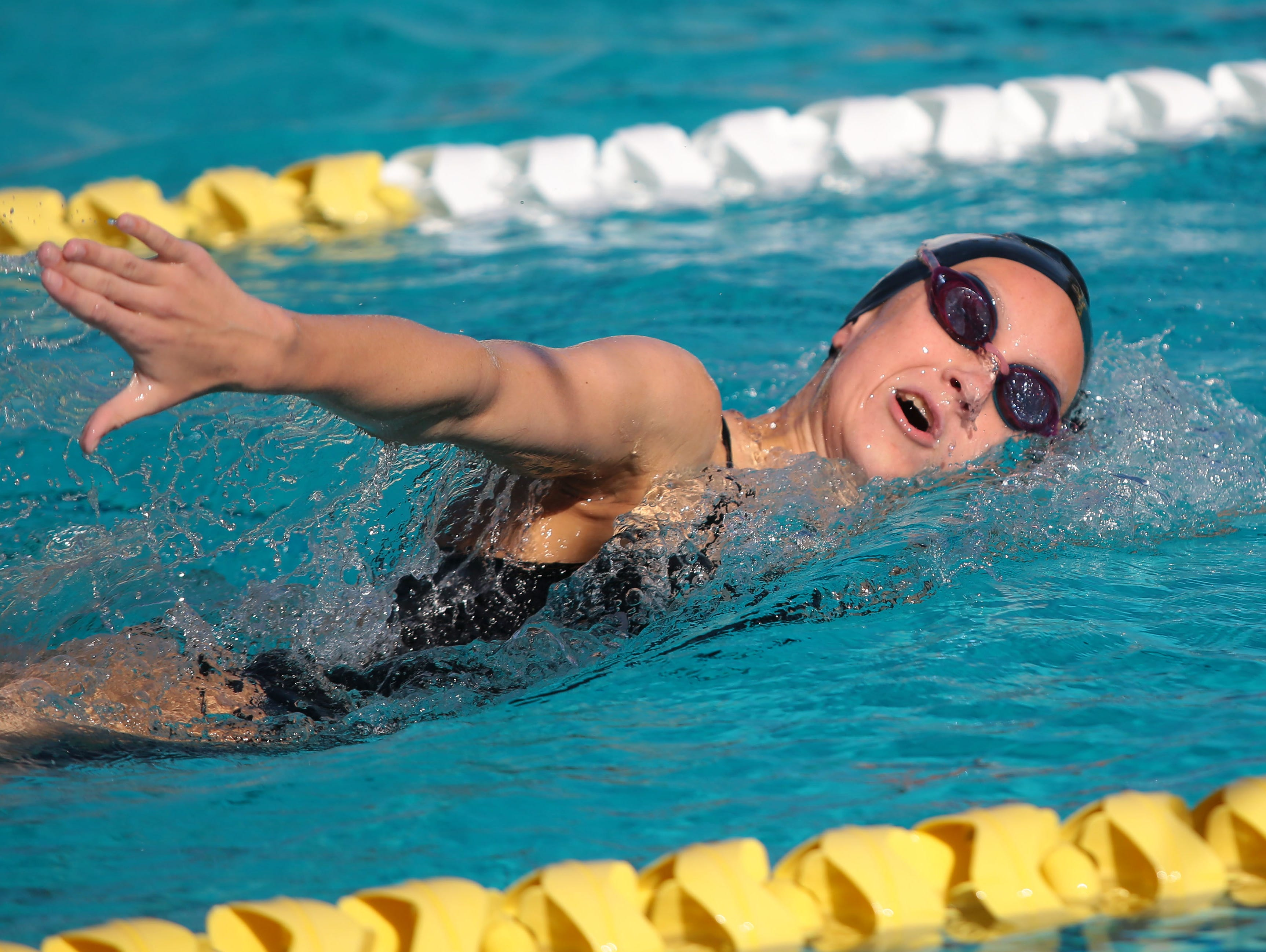 Xavier's Emma Johanson swims to a win in the 500 freestyle as Palm Springs hosts Xavier in a high school swim meet on Monday, April 25, 2016, at the Palm Springs Swim Center.