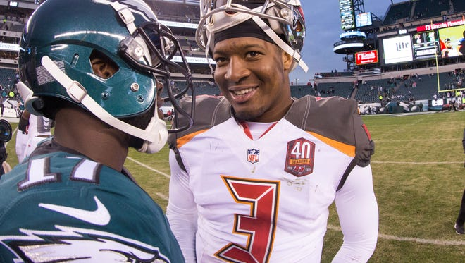 Tampa Bay Buccaneers quarterback Jameis Winston (3) talks with Philadelphia Eagles wide receiver Nelson Agholor (17) at the conclusion of the game at Lincoln Financial Field.