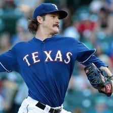 ARLINGTON, TX - AUGUST 13: Miles Mikolas #36 of the Texas Rangers throws in the first inning against the against the Tampa Bay Rays at Globe Life Park in Arlington on August 13, 2014 in Arlington, Texas. (Photo by Rick Yeatts/Getty Images)