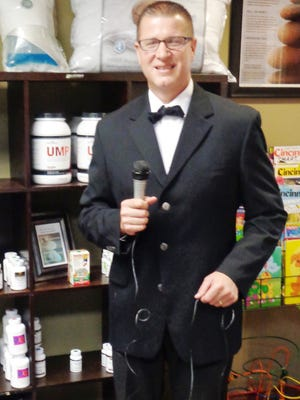 """Dr. Doug Portmann, dressed as TV's """"The Price is Right"""" game show host Drew Carey, created the Halloween edition to be played in Historic Milford Oct. 28."""