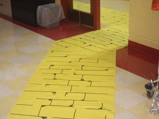 """Carmella Heer, principal, Max Leuchter School, celebrated back to school with members of her staff. Heer chose a """"Wizard of Oz"""" theme, which included a yellow brick road."""