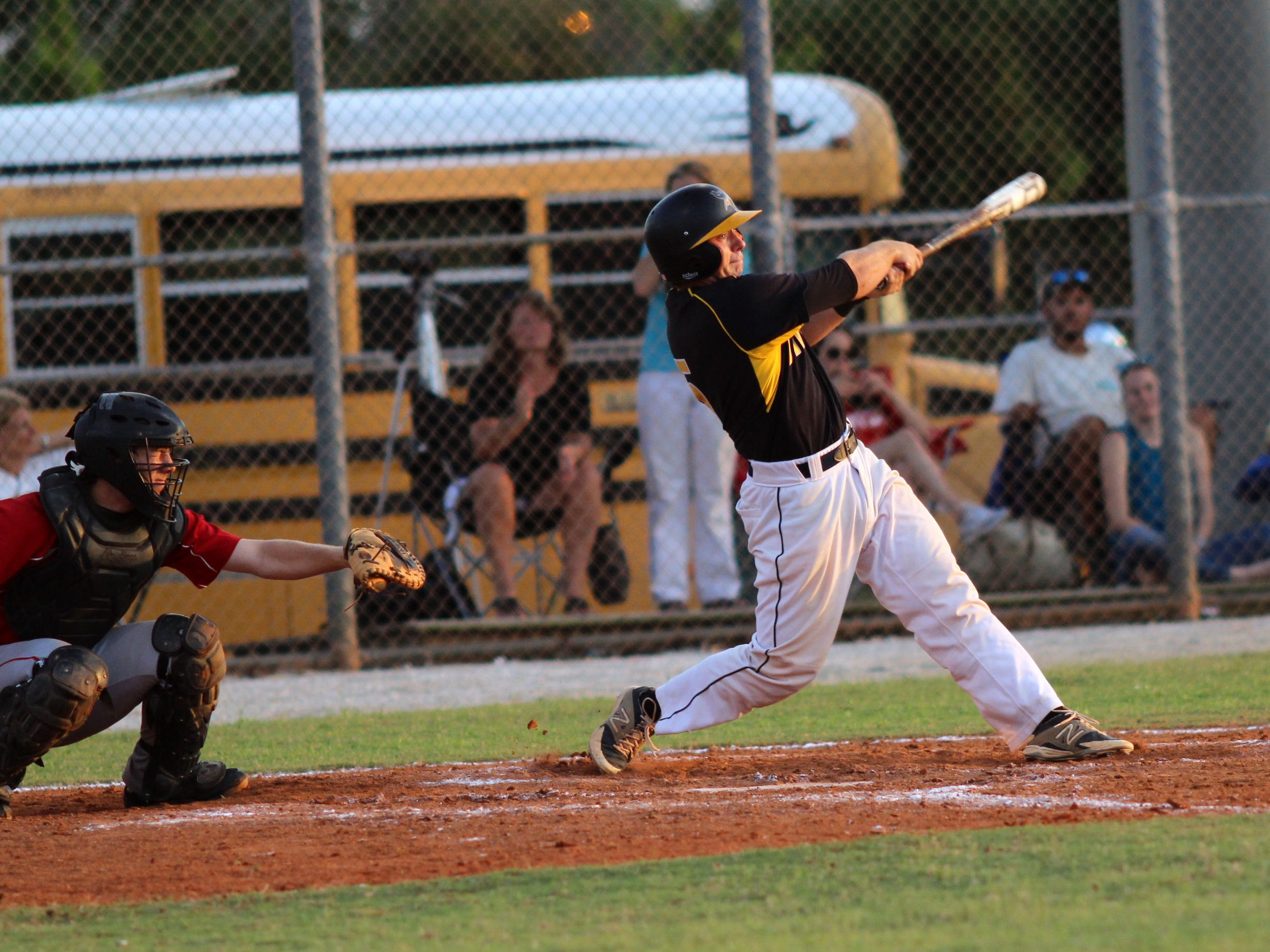 Micheal Richey swings during Friday's district final game against LaBelle.