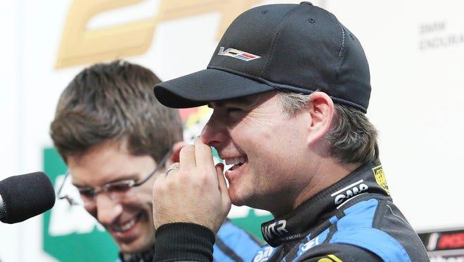 Jeff Gordon, right, laughs beside Rolex 24 teammate Jordan Taylor during a Jan. 6 event at Daytona International Speedway.