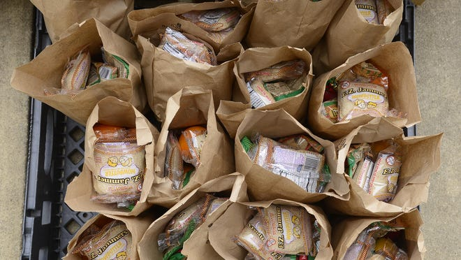 Bags of food sit during a food distribution March 31 at Gadsden City High School. the Alabama Cooperative Extension Service and other groups are trying to gauge how much the COVID-19 pandemic has increased food insecurity in the state.