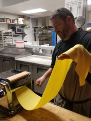 Chef Troy Heller prepares pasta for Cacciatore at Heller's
