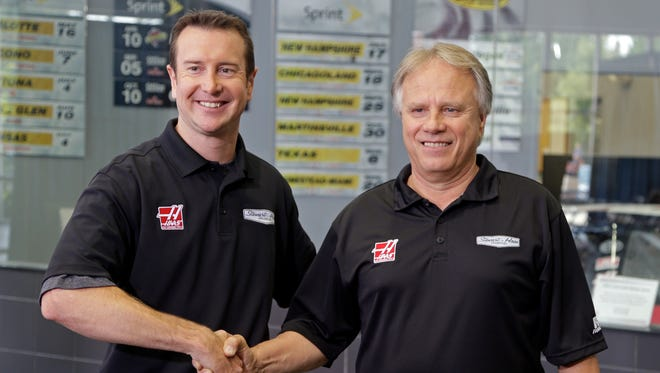 Stewart-Haas Racing co-owner Gene Haas, right, poses with new addition Kurt Busch after their news conference Tuesday.