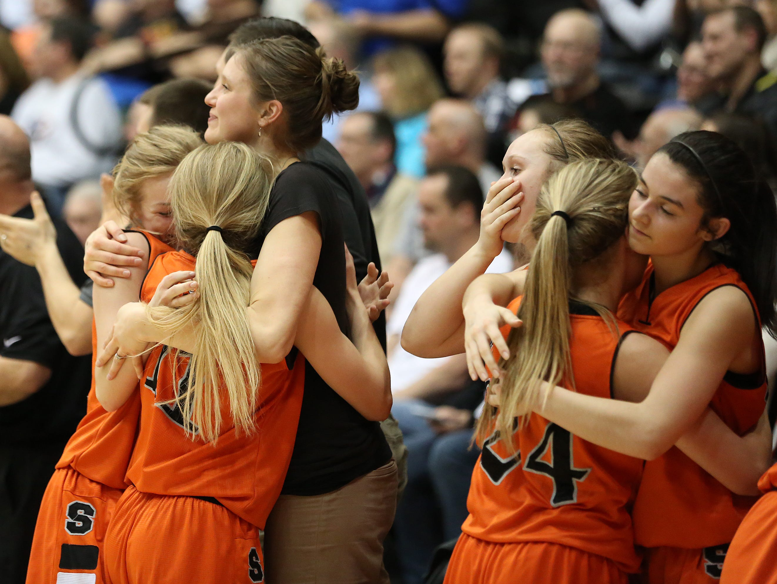 Silverton players embrace as the Foxes fall to La Salle 42-28 in the OSAA Class 5A state championship on Friday, March 10, 2017, at Gill Coliseum in Corvallis.