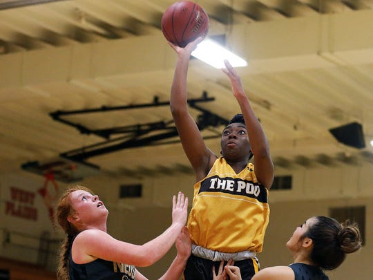 Kickapoo High School senior Jordan Sanders (27) shoots
