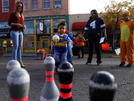 Ethan Randall-Frank prepares to roll a pumpkin during a bowling game hosted by Farmington Parks, Recreation and Cultural Affairs during last year's Boo-Palooza celebration on Main Street in Farmington.