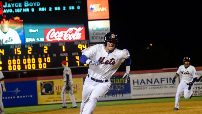 Binghamtonâ??s Gavin Cecchini runs toward third after Jayce Boyd hits a single towards center during the third game in the Eastern League Championship Game at NYSEG Stadium on Friday.