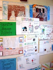 Figurative language posters and Geo-Town Geometry posters were among the projects displayed during Achievement Night at Petway Elementary School.