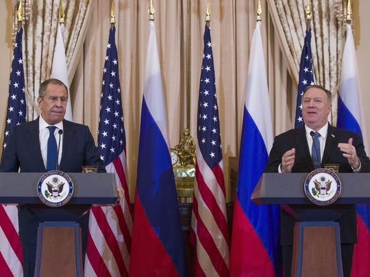 Russian Foreign Minister Sergey Lavrov, left, listens as Secretary of State Mike Pompeo speaks during a media availability, after their meeting at the State Department, Tuesday, Dec. 10, 2019, in Washington. (AP Photo/Alex Brandon)