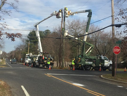 Vineland Electric Utility crews repair a damaged utility