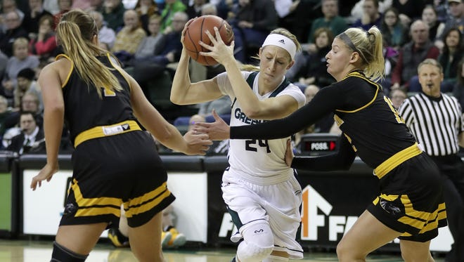 UWGB guard Allie LeClaire (24) splits the UW-Milwaukee defense Saturday at the Kress Center in Green Bay.