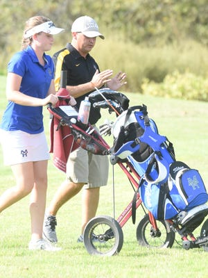 Mountain Home's Kenzie Collins and coach Dell Leonard discuss strategy during the Class 6A State Tournament at Big Creek Golf & Country Club. Collins competed at the Overall State Tournament on Thursday in Little Rock.