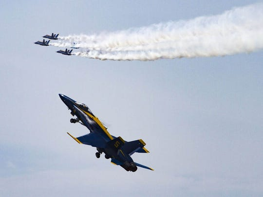 The Blue Angels perform a  Delta Flat Pass/Pitch up