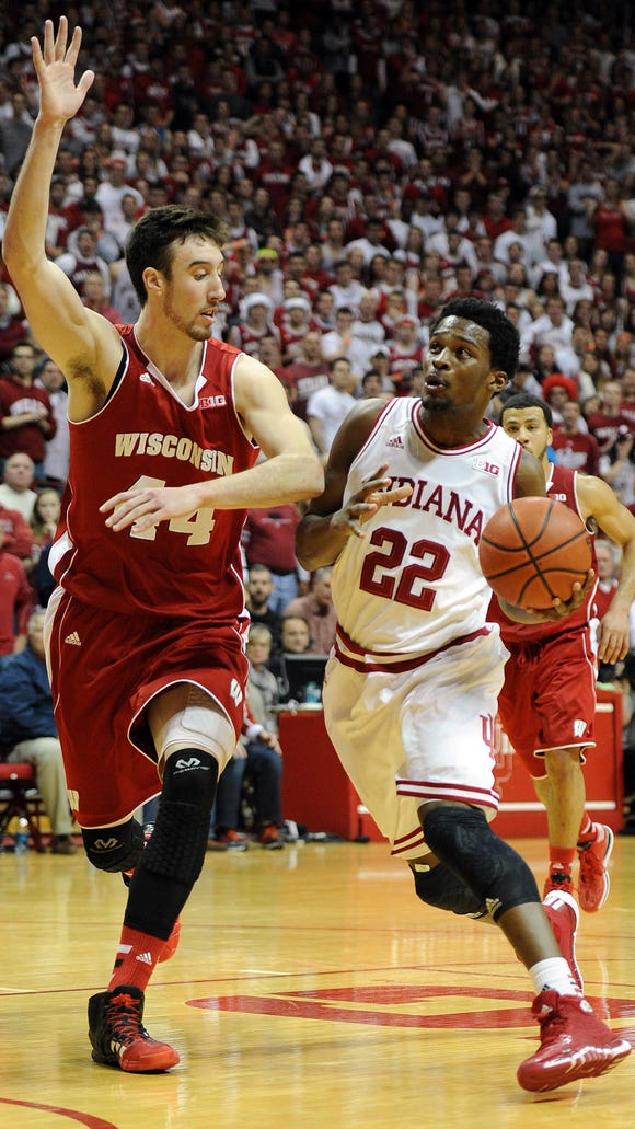 Could Frank Kaminsky (left) be a unanimous preseason Big Ten player of the year pick this week?